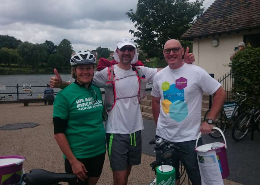 Mark 'Harry' Harrison (centre) is taking part in a 230-mile charity run across three days. Pictured with partner Lorraine Farley and Shaun Govan. Picture: Zach Ward