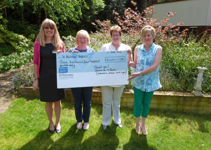 Miranda McCoy, St Nicholas Hospice Care Community Fundraiser, receives a cheque for �3,400 from Lynn Dolder, Diane Thorrold and Catherine Gooderham.