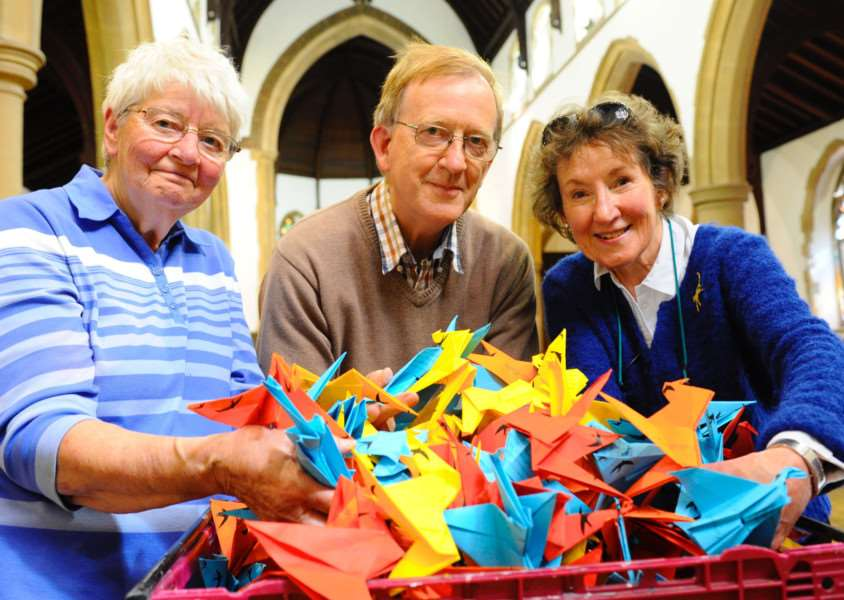 "A new art exhibition featuring a thousand paper cranes is in its final stages pictured are Margaret Griffiths, Ian Carstairs and Lesley Rock with some of the paper cranes called ""Flight of a thousand cranes"" as part of the UN international day of peace 21st September. Picture: MARK BULLIMORE"