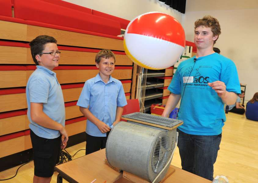 CHAOS from Cambridge University were at Harleston Archbishop Sancroft high school to do Science workshops''Pictured: Alex Denny and Kyle Love from Alburgh with Denton School having a go at the 'Air Streams' watched on by Louis Colguhoun from CHAOS ANL-150107-154449009