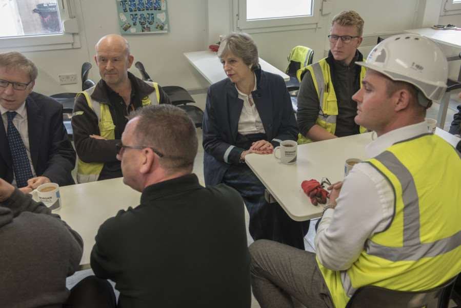 United Kingdom Prime Minister Theres May visits Chapel Green School build site, Norfolk, for mental health visit. �Crown.