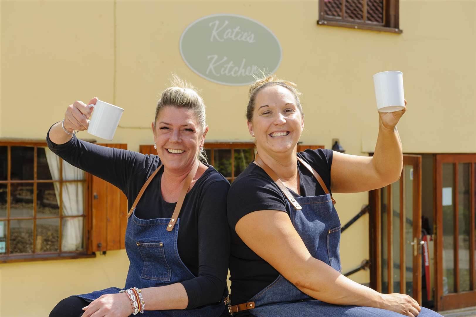 Diss, Norfolk. Katie Rich (left) owner of Katie's Kitchen in Hales Yard has sold it to Katie Devereux (right)..Picture: Mark Bullimore. (2313349)