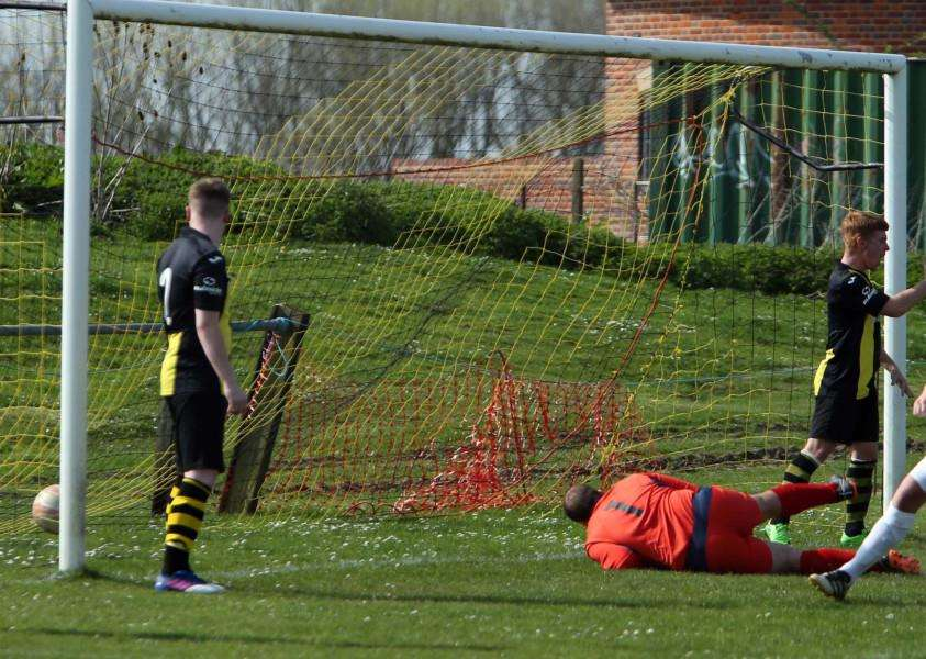 DAY TO FORGET: Johnny Kerridge scores one of Framlingham's five goals at Debenham on Saturday. Picture: Dean Warner