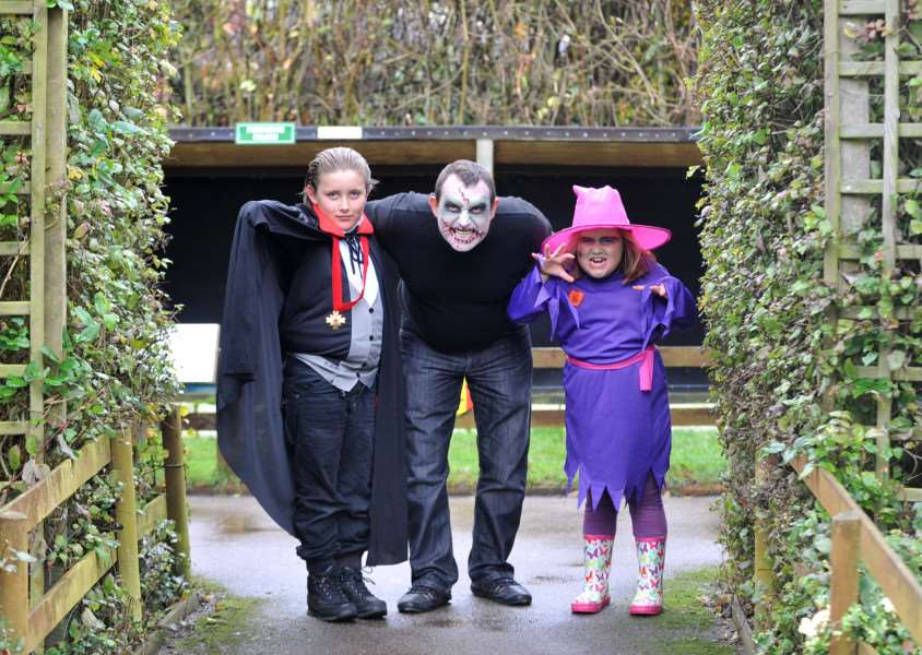 Halloween Hoot at Suffolk Owl Sanctuary''Pictured; General Manager Andy Hulme with his children Alfie (8) and Rosie (7) ENGANL00120121029095719