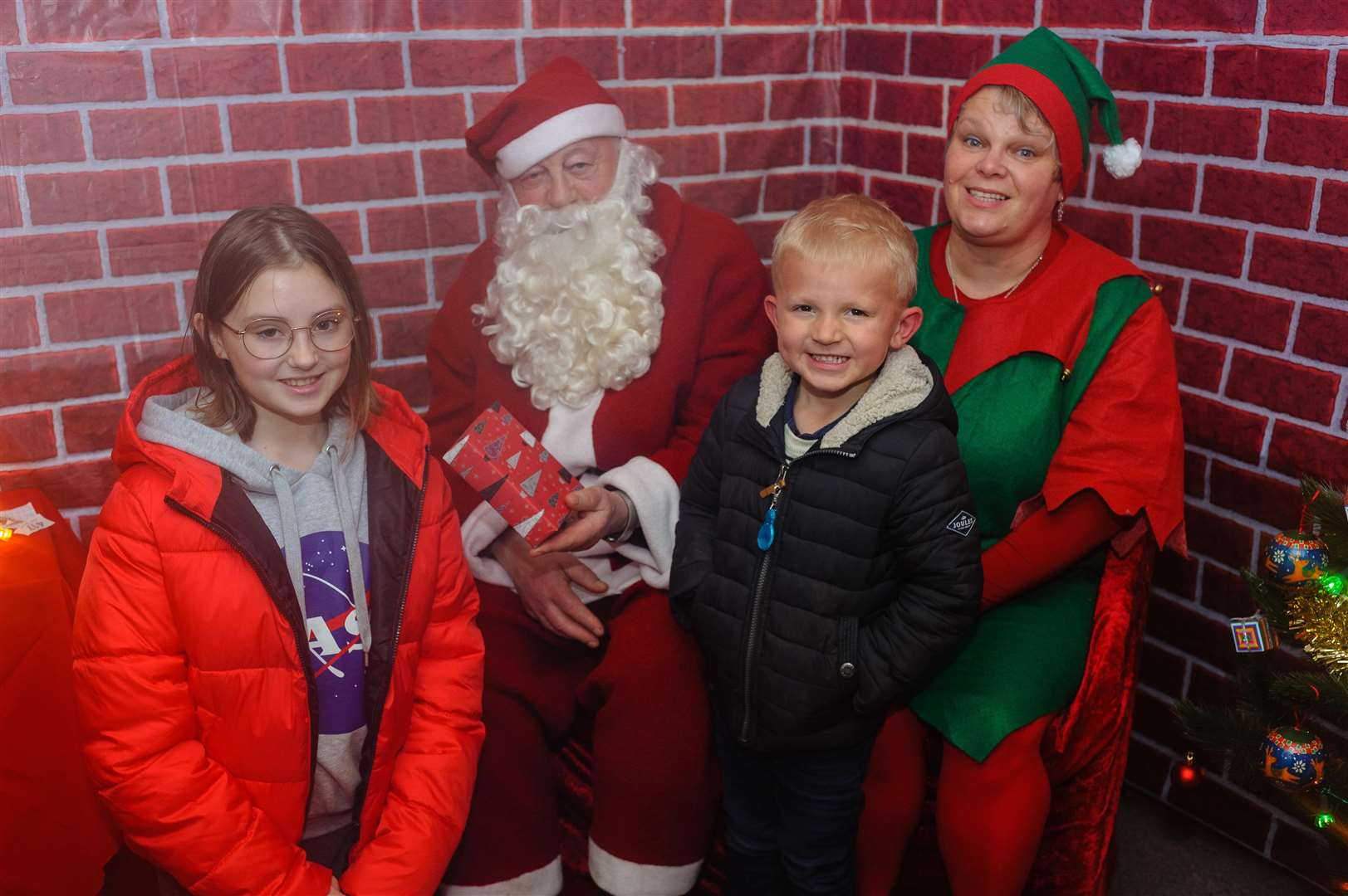 Lilia and Will Eden with Santa and his Elf.
