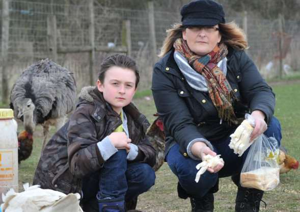 Smallholder Nicola Johns has had a duck and a guinea fowl shot leading to fears over more random attacks. Pictured: Nicola Johns and son Jake ANL-150204-084119009