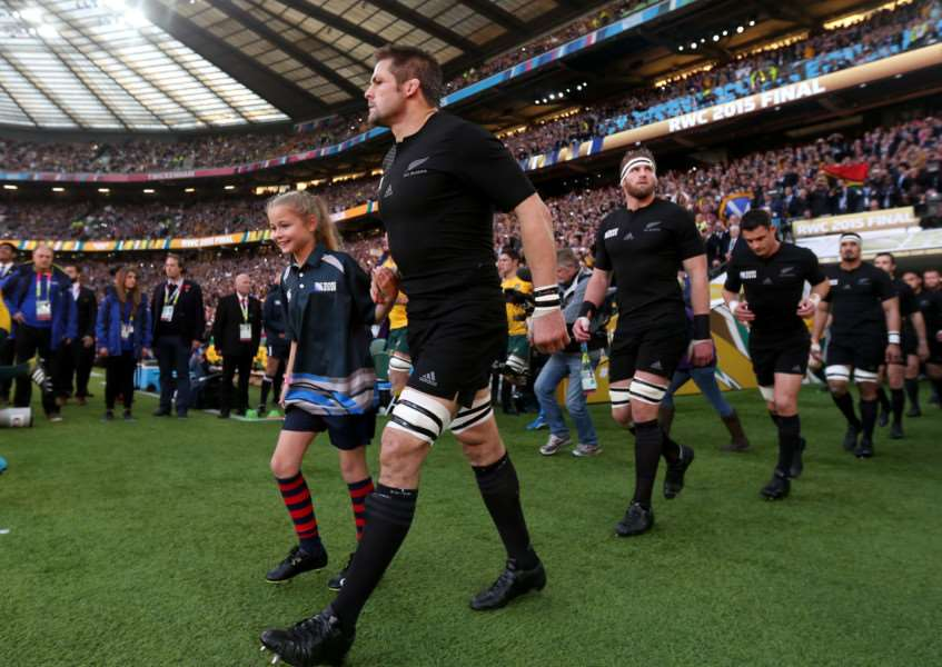 New Zealand captain Richie McCaw walks out for the Rugby World Cup final at Twickenham with Brooke Felming. 'Photo: David Davies/PA Wire. EMN-150311-155929001