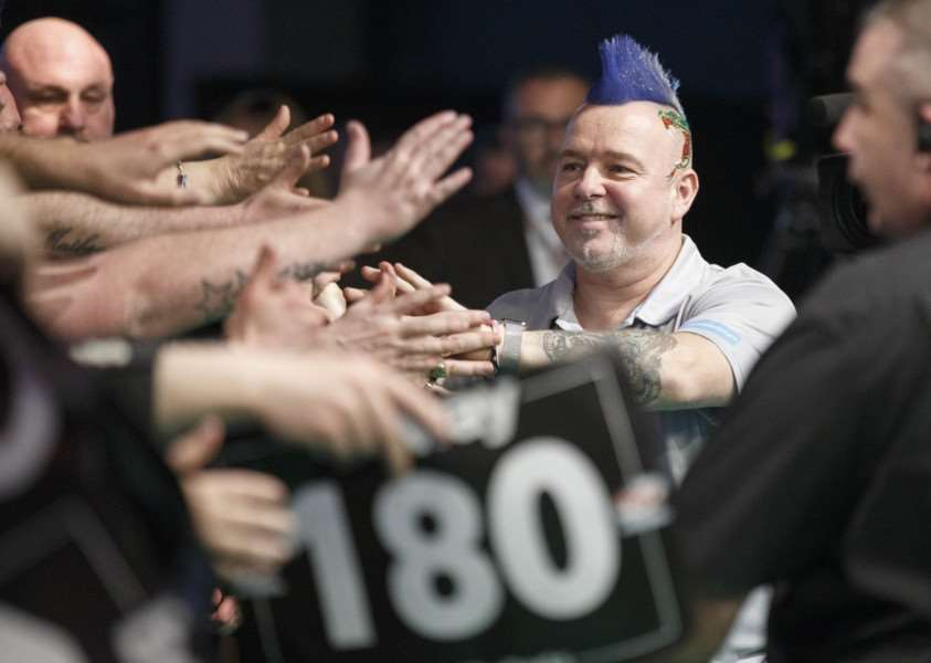 HOME WELCOME: Peter Wright interacts with the crowd before taking on Gary Anderson at The SSE Hydro in Glasgow last week. The Scottish-born thrower was beaten 7-5 by his World Cup teammate in the final game of the night