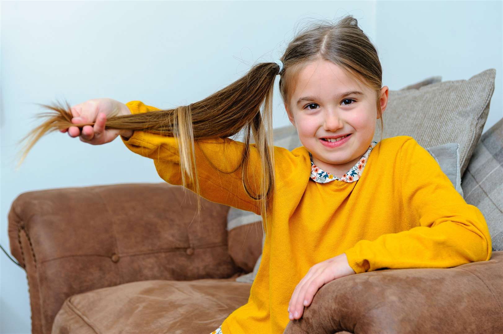 MAKING THE CUT: Seven-year-old Maisie will donate her hair to The Little Princess Trust. Picture by Mark Bullimore Photography.