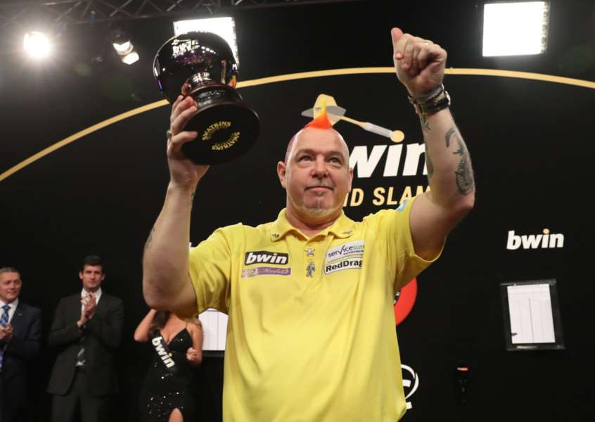 RUNNER-UP: Peter Wright salutes the Wolverhampton crowd after losing 16-12 to Michael van Gerwen in the final of the bwin Grand Slam of Darts on Sunday night (Picture: Lawrence Lustig/PDC)