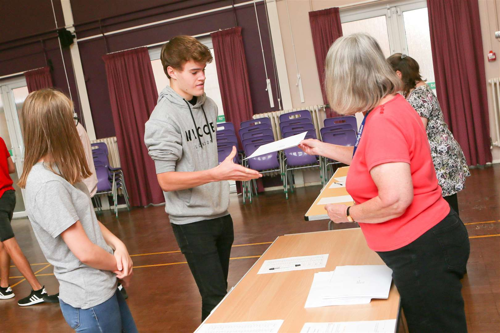 Diss High School Students collect their results.