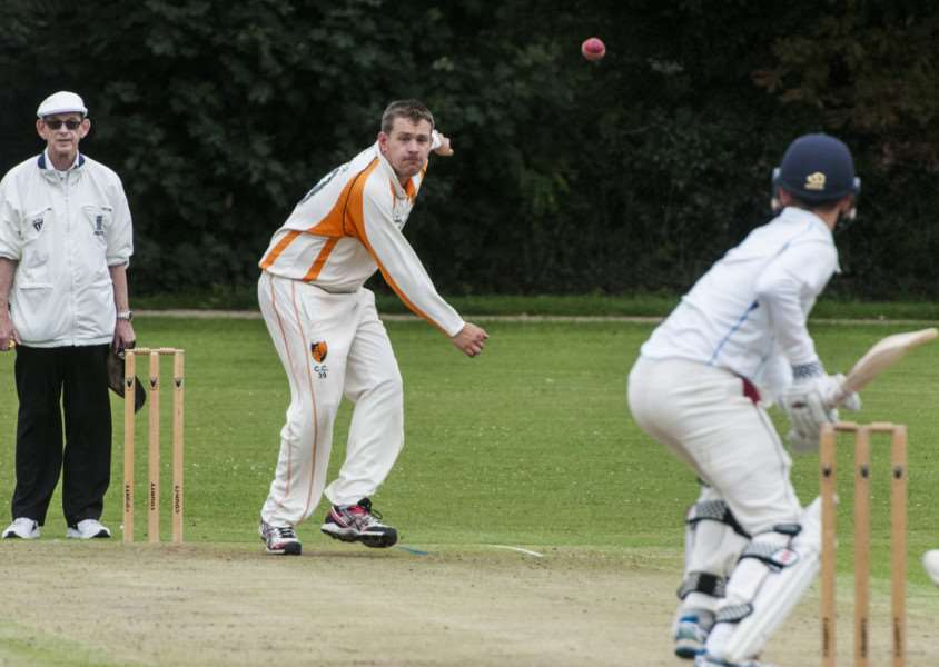 WASHED OUT: Chris Cooper in action during Diss' abandoned match at the weekend