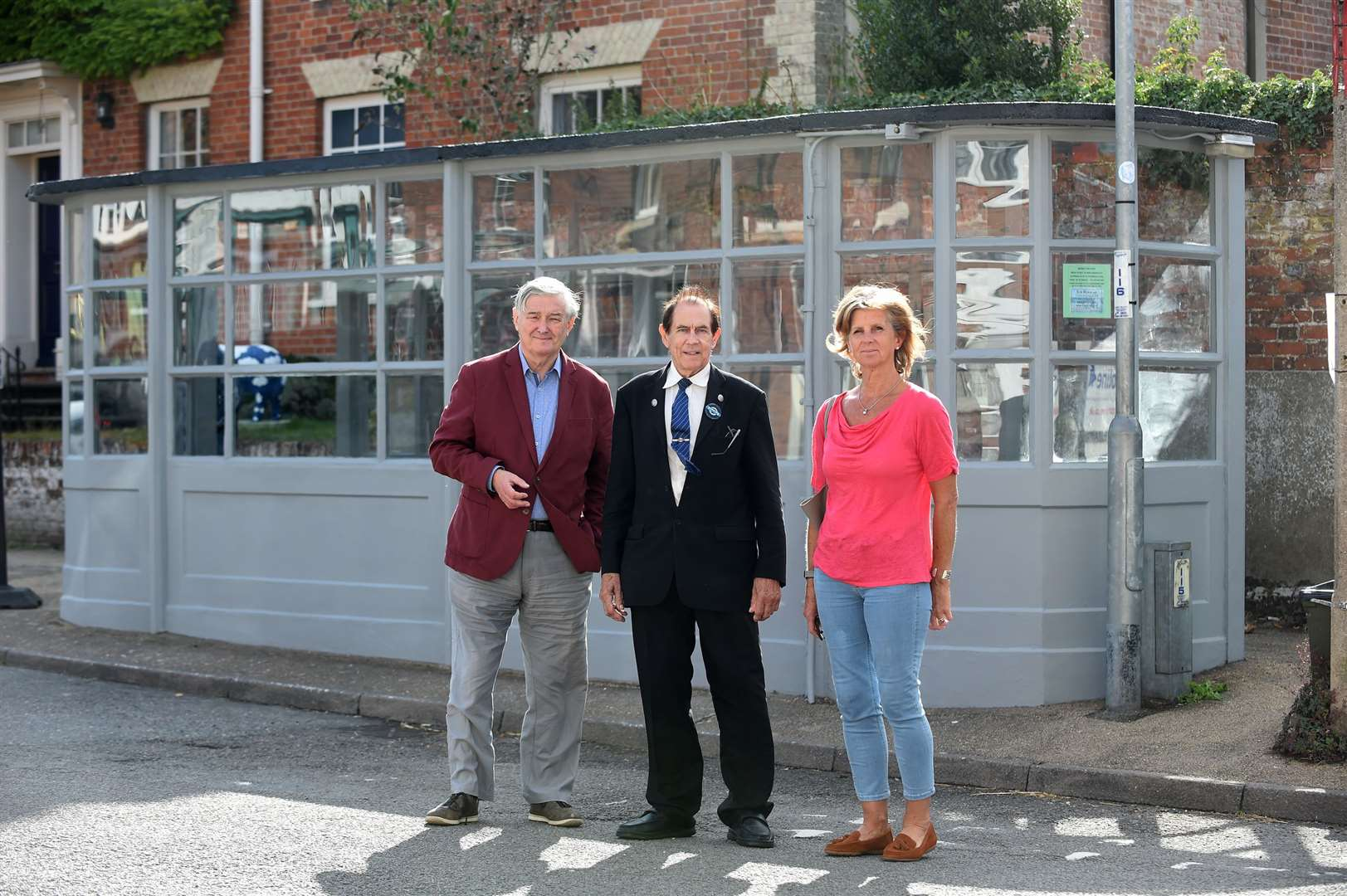 County councillor Guy McGregor, bus operator Jeff Morss and Eye mayor Jane Hudson in front of the bus shelter. Picture by Mecha Morton.