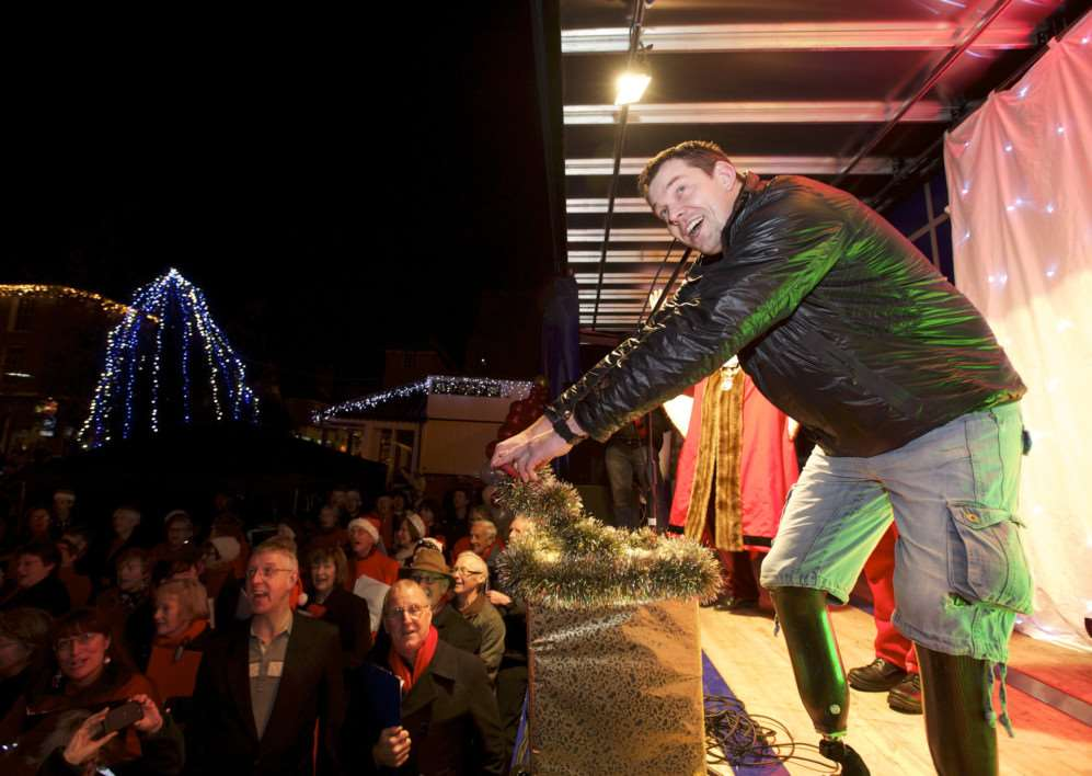 Diss, Norfolk. Diss' Christmas Lights Switch on in the Market Place - Duncan Slater switches on the lights ANL-141130-210649009