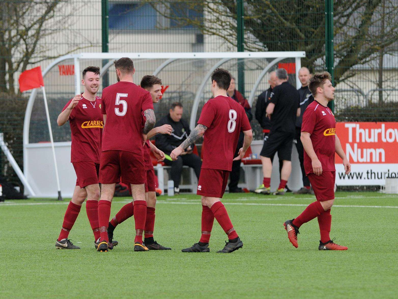 THREE AND EASY: Walsham celebrate their third goal at Haverhill Borough. Picture: Mecha Morton