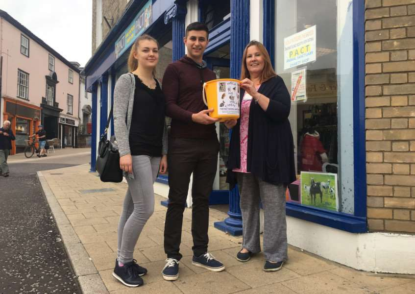 Sandra Kreivenaite and Bilal G�n�lsen hand over collections to PACT store manager Julie Sommerville. Picture: Andrew Martin.