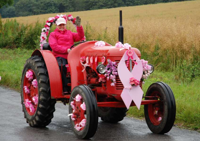 Event organiser Annie Chapman leads the way for the Pink Ladies Tractor Road Run 2014. ANL-140707-094413001