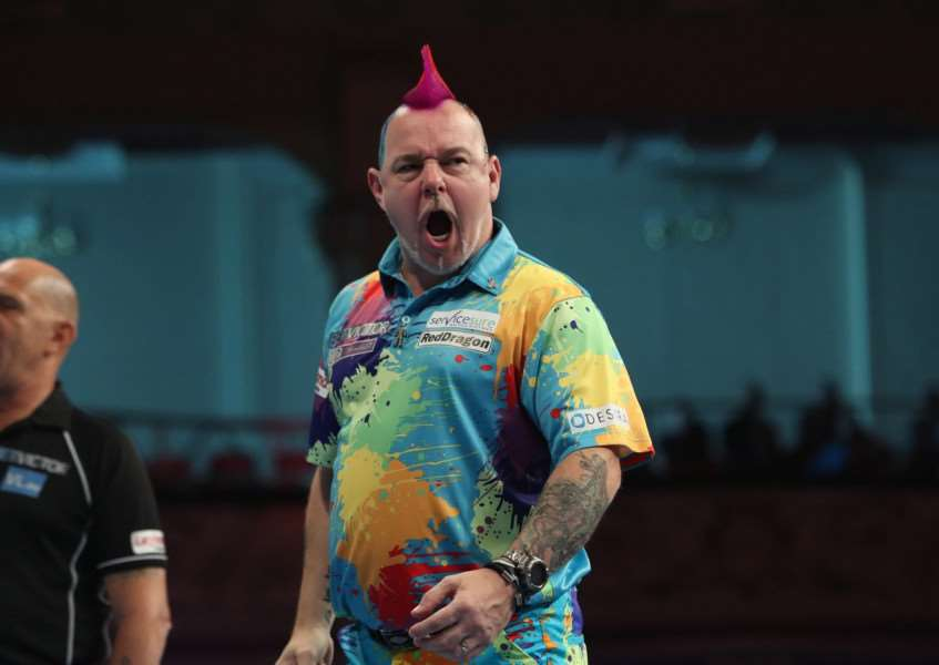 CHAMPION: Peter Wright. Picture: Lawrence Lustig