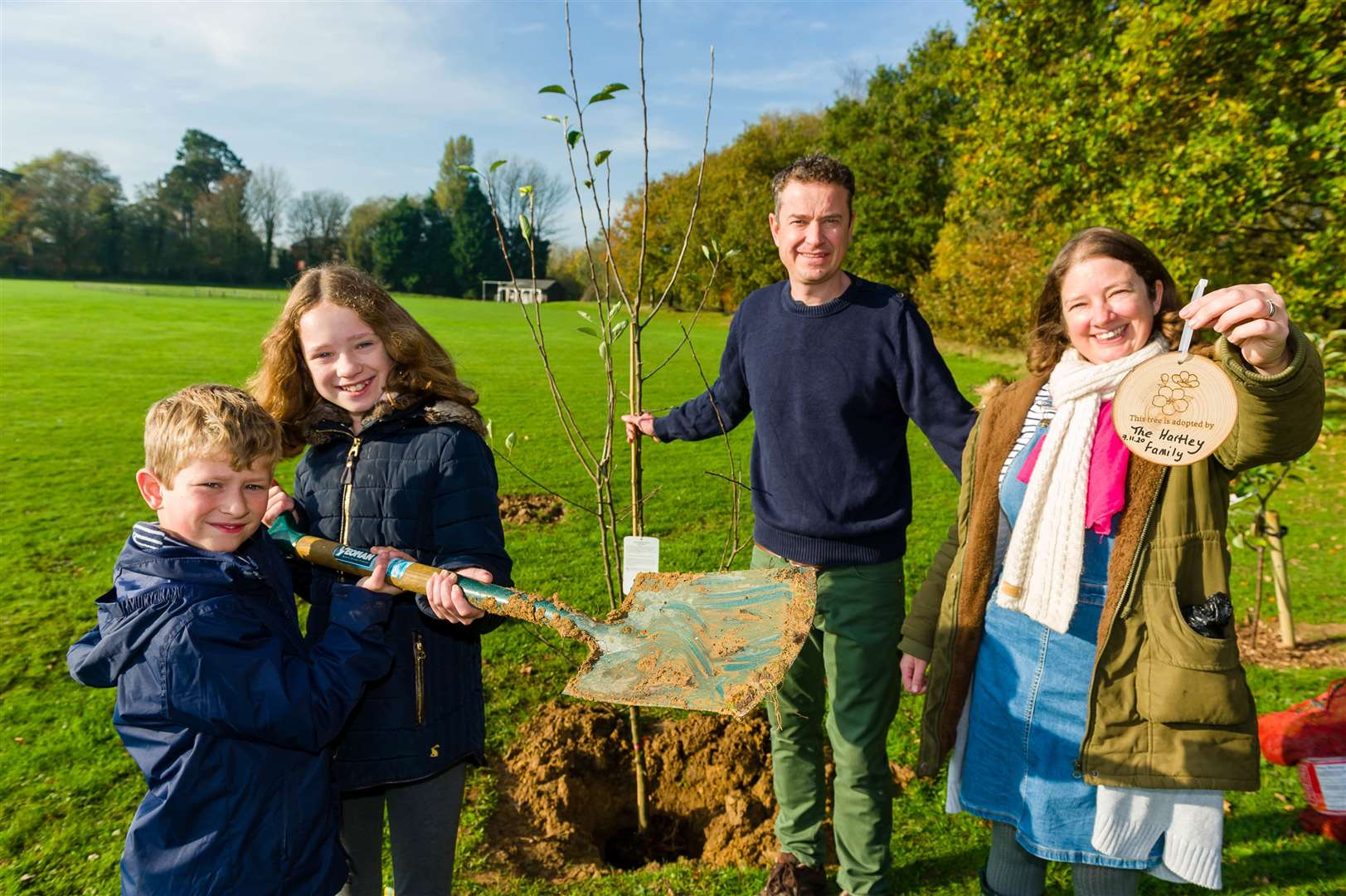 Harry, Annabelle, Jonathan and Mandy Hartley with the tree that they planted on the common in New Buckenham..Picture: Mark Bullimore Photography.