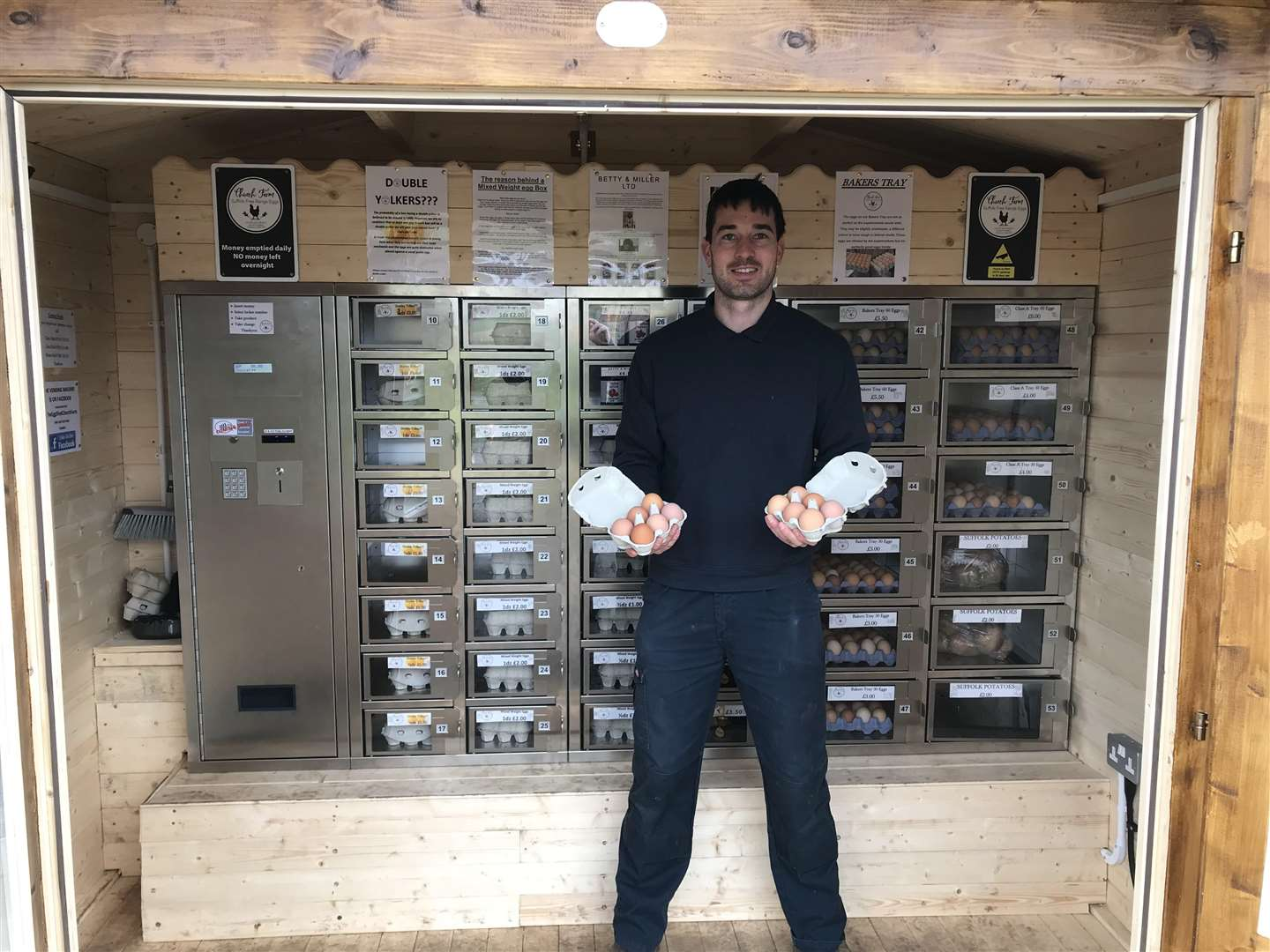 EGG-CELLENT: Chris Hull shows off the fresh produce, which is in individual vending machine lockers, only unlocking after payment.