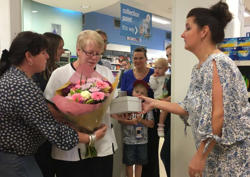 Diane Ruddock surrounded by friends and colleagues on her final day of work at Boots in Diss. Picture: Andrew Martin.