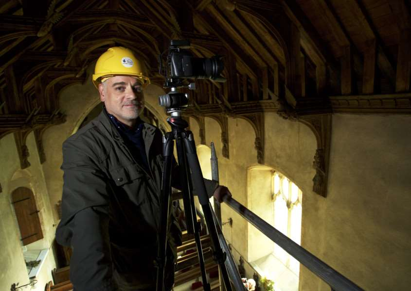 Gissing, Norfolk. St Mary's Church in Gissing has won a �280,000 grant from the Heritage Lottery Fund to carry out urgent repairs. Pictured is Michael Rimmer of Angel Roofs photographing the Angel carvings in the roof vaulting which is the first part of the project.''Picture: MARK BULLIMORE ANL-161029-212829009