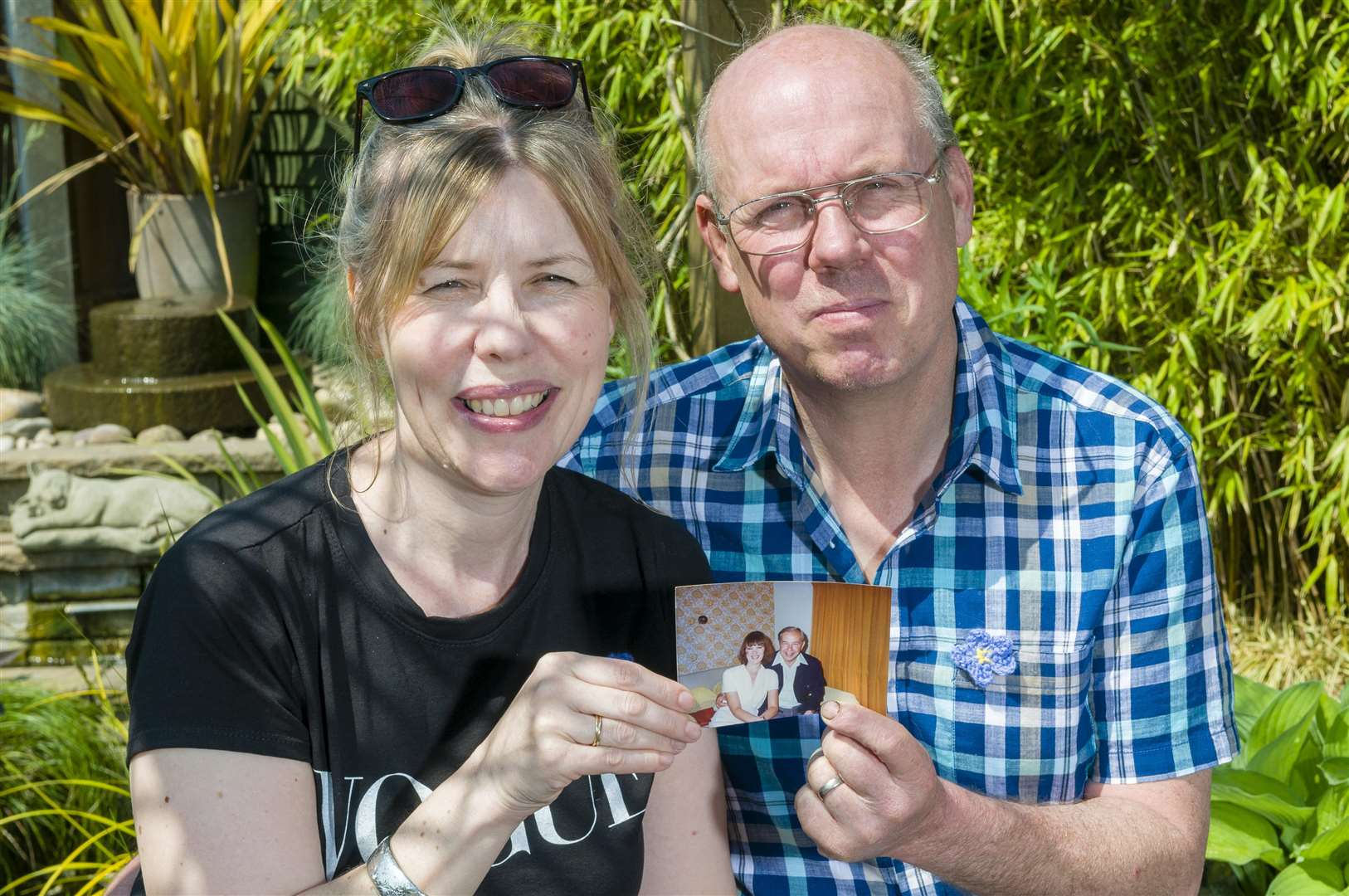 Long Stratton, Norfolk. Nicola King lost both her parents to dementia and is now setting up a family fun evening, and potentially a mobile dementia cafe, in their memory, she's pictured with her husband Andrew King. They're pictured holding a picture of her parents George and Annie Flaherty.Picture: Mark Bullimore Photography (2186880)