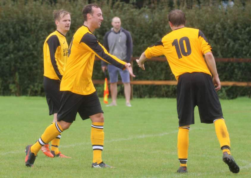 HIGH FIVES: Chris Collins-Reed (left) celebrates his goal for Scole