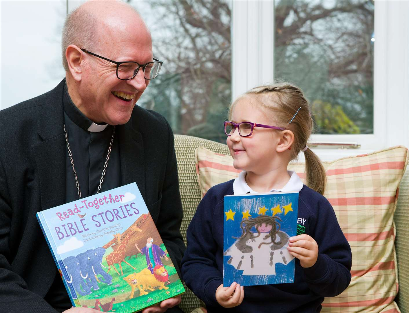 Rt Rev Martin Seeley, Bishop of the St Edmundsbury and Ipswich Diocese with Willow Brown and the Christmas card she designed
