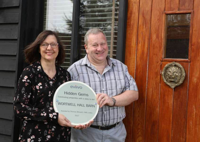 Jenny and Clive Aylett, owners of Wortwell Hall Barn, with their Hidden Gem award.