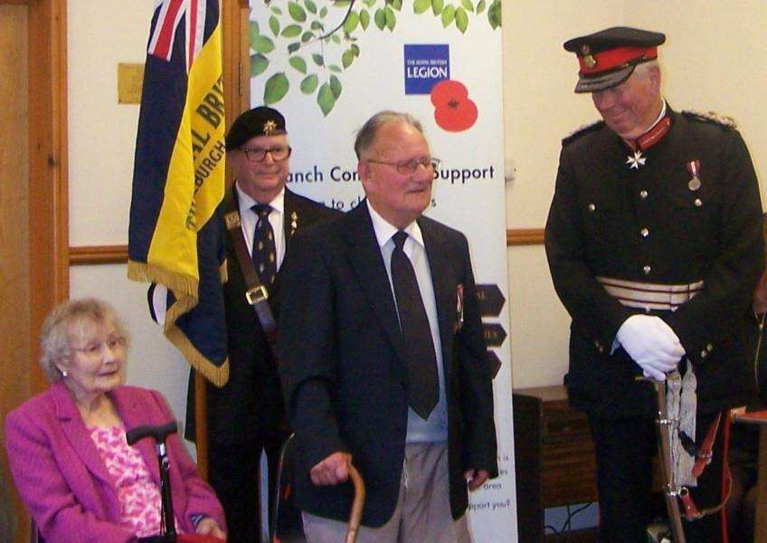 Horace Boewn wioth wife Beryl, receiving L�gion d'honneur award from Lord-Lieutenant for Norfolk, Richard Jewson, at a meeting organised by the Dickleburgh and District Branch of the Royal British Legion. Submitted picture.