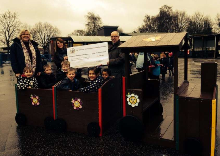 South Norfolk Councillor Martin Wilby (right) presents cheque on behalf of Saffron Housing to Manor Field School's PTA members and Eco Council pupils. xsevnpUM4VViCh0C8cA0