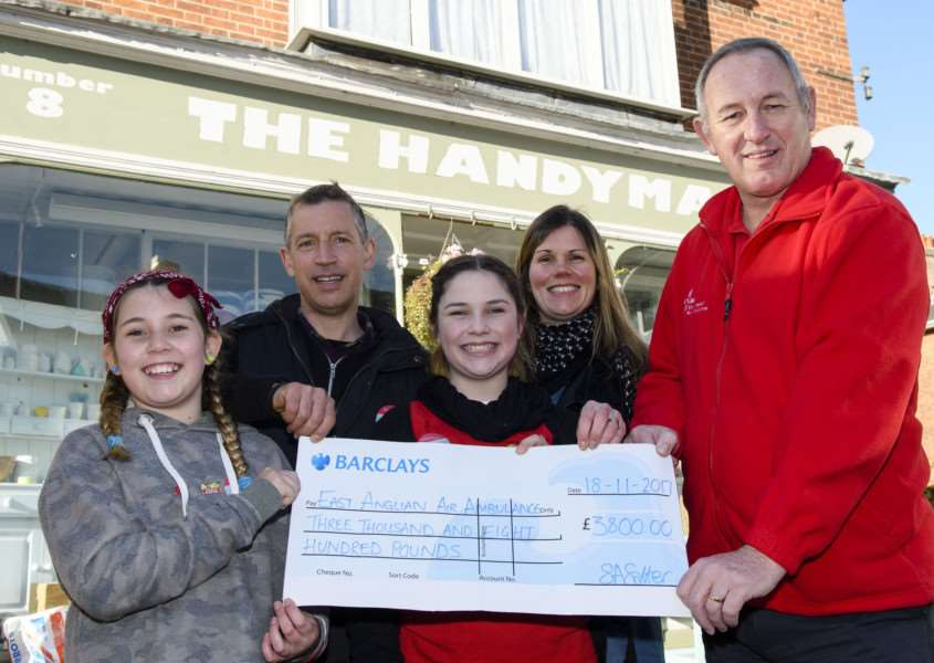 Eye, Suffolk. Cake Sale in aid of East Anglian Air Ambulance 10am-12pm outside the Handyman in Eye. and cheque presentation for �3800 to EAAA, which was raised through a charity ball on 21st October 2017 held at Eye Town Hall. Pictured are Bruce, Ruby, Sally and Rose Salter with Terry Wigg of EAAA.''Picture: MARK BULLIMORE PHOTOGRAPHY