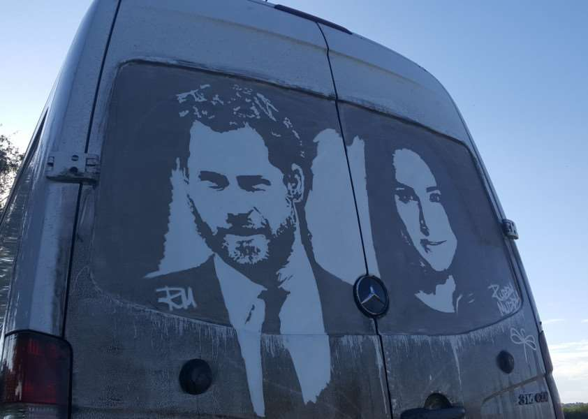 Prince Harry and Meghan Markle artwork on the back of a muddy van - created by artist Ricky Minns, 43, also known as Ruddy Muddy. PHOTO SWNS.