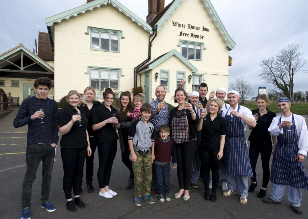 Stoke Ash, Suffolk. White Horse Inn Stoke Ash Best Bar 2014 - owners Shane Aldridge and Anne Cronin pictured with staff and their family ANL-141220-212217009