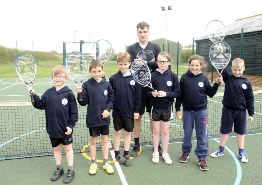 Tennis Coach Mr Lameroux, coaching kids from Mendham and St Edmunds Primary schools.
