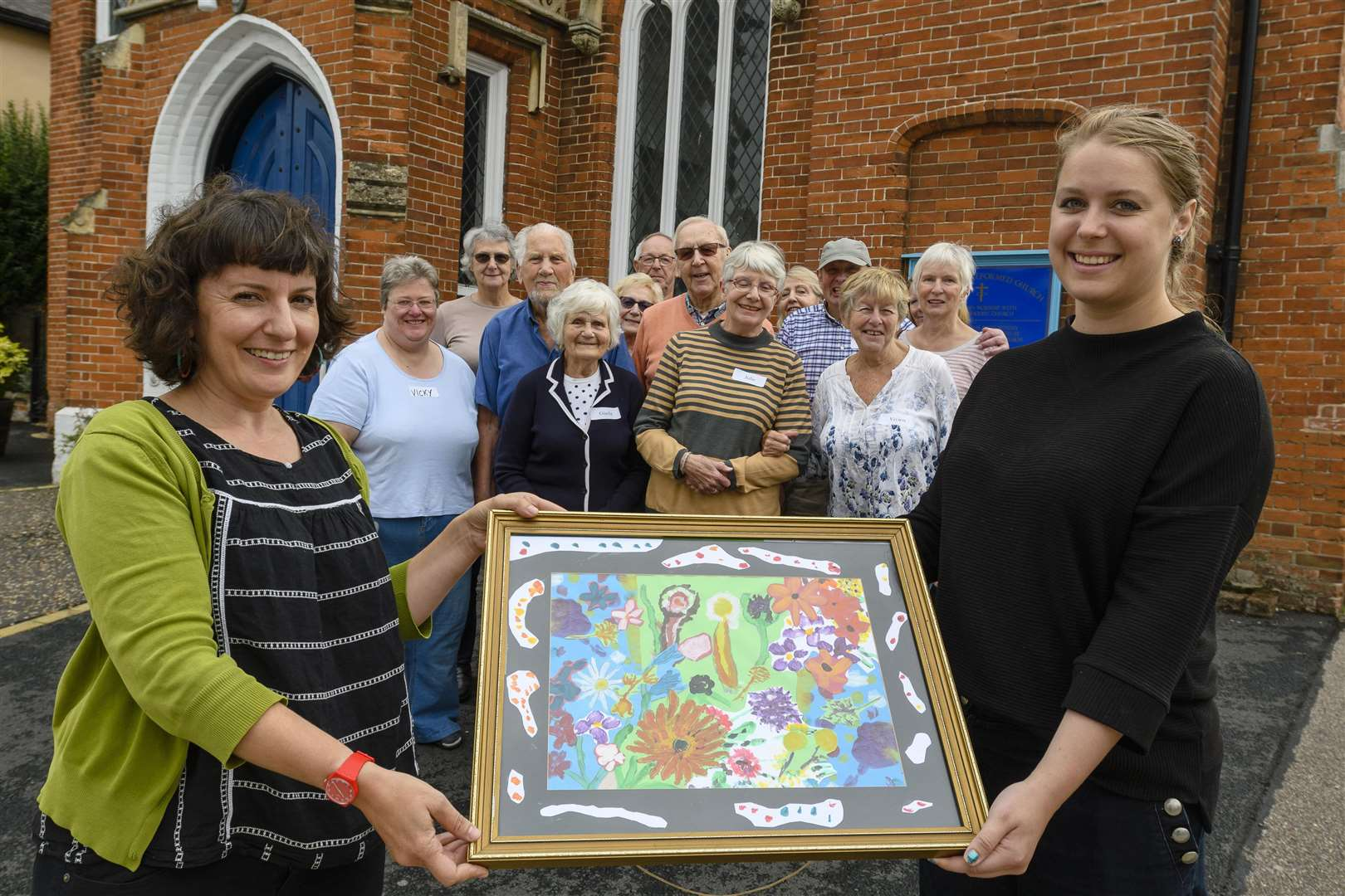 Age UK Norfolk dementia lead, Amelia Borley and Jessica Vincent, Corn Hall outreach worker, at the Untied Reformed Church, Diss, with some of the service users and volunteers who have taken part in the exhibition. Picture by Mark Bullimore Photography.