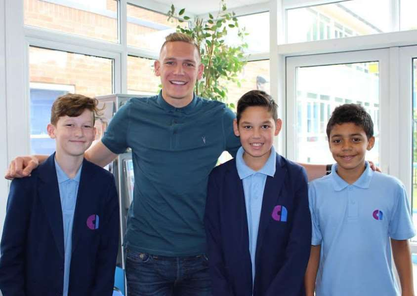 ACADEMIC ROOTS: Cheltenham Town centre-forward Danny Wright spoke to pupils when he returned to Attleborough Academy.