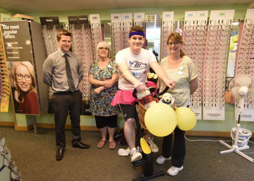 Specsavers Staff at Diss are fundraising for a guide dog charity, using an excercise bike. ANL-150710-172113005