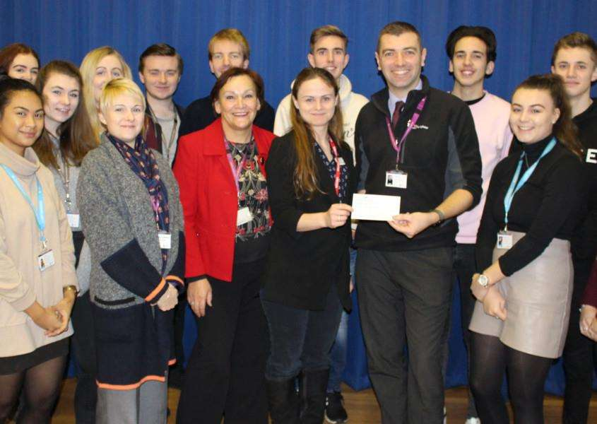 Attleborough Academy Sixth Form hand over a cheque for �580 to the Teenage Cancer Trust. Submitted picture.