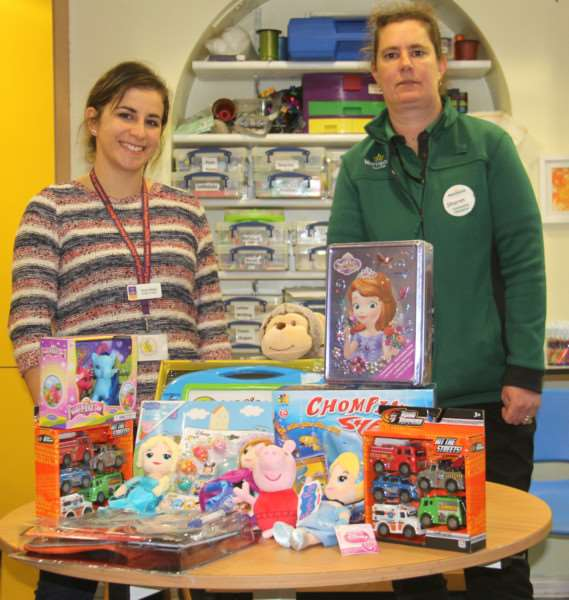 Emily Weeks, EACH Activities Assistant and Sharon Eakers, Morrisons Community Champion with a selection of the toys donated ANL-160712-155637001