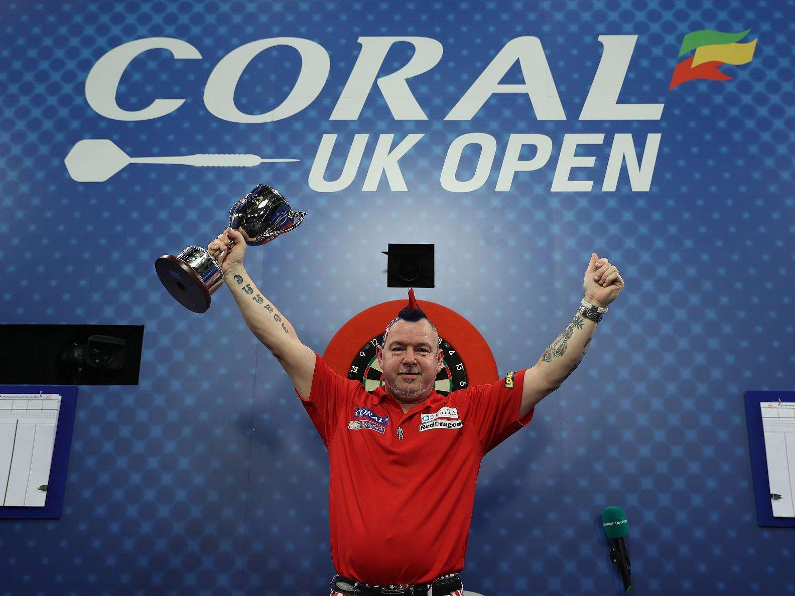 MAIDEN MAJOR: Peter Wright holds aloft the UK Open trophy after his win over Gerwyn Price