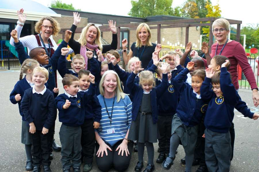 Diss, Norfolk. Diss Infant and Nursery School with Children's Centre has been given a 'good' rating in their Ofsted report. Pictured are staff and pupils celebrating their success with deputy head teacher Lyn Schug front. Picture: MARK BULLIMORE PHOTOGRAPHY