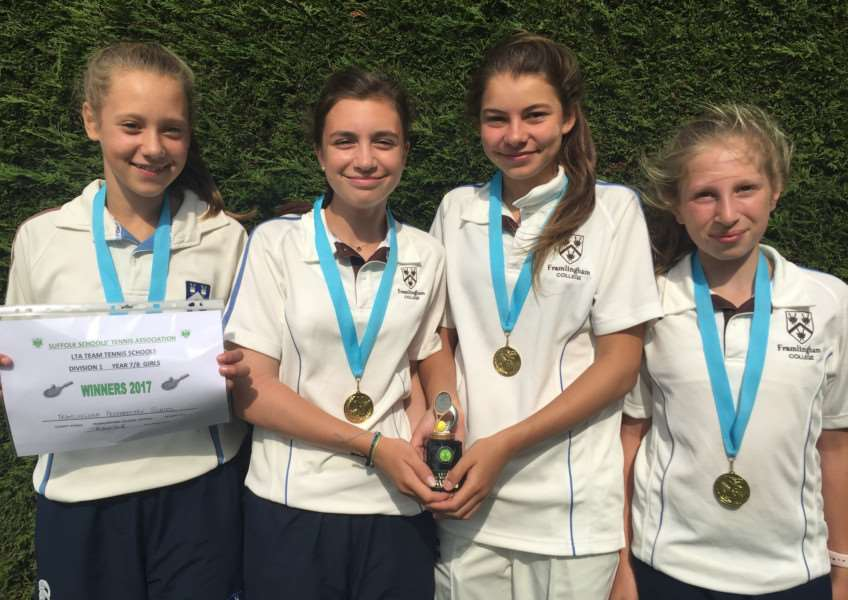 CHAMPIONS: The Under-13 girls show off their medals