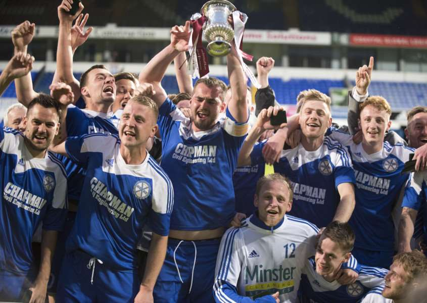 CHAMPIONS: AFC Hoxne celebrate winning the Suffolk Junior Cup at Portman Road last night