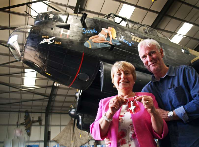 Carol Wiles MBE, of Harleston, with husband Malcolm in front of an Avro Lancaster. ANL-160206-102105001