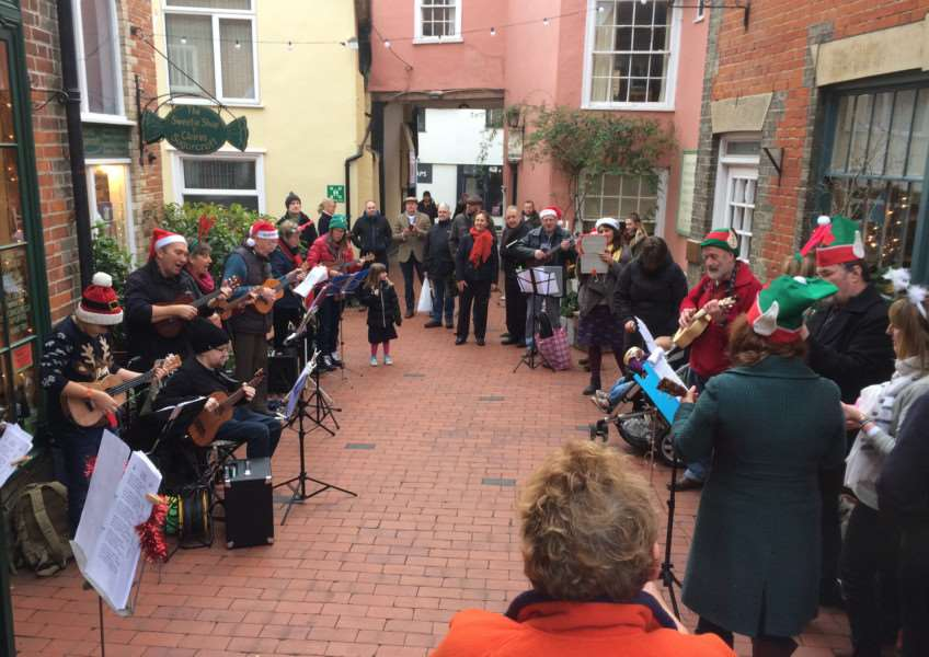 Ukaholics Anonymous playing at the St Nicholas Christmas Fayre, in Norfolk House Courtyard, Diss. ANL-161219-113140001