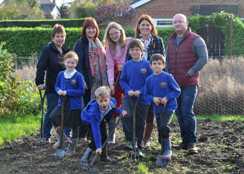 A new project between The Crown Inn, who are paying for allotments for school pupils, and Pulham Market Primary School, called 'Our Norfolk, Our Pulham, Our Food'. Pictured: Pupils along with Head Teacher Simone Goddard, School Gardener Kim Jones and Jon Bingham and Amy Beevers from The Crown ANL-151111-152333009